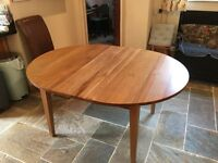 Solid oak drop leaf extending dining\kitchen table