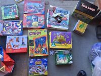 Bundle of children's jigsaws, game, bug barn and some story & music CDs.