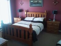 Solid wood kingsize bed with 2 side draws and chest of draws with mirror