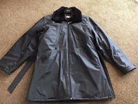 BLACK SHOWERPROOF COAT IN SIZE 16