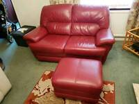 Dark red leather 2 seater sofa with matching chair and storage footstool