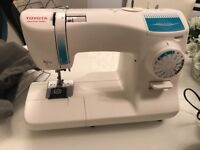 Toyota SPB15 sewing machine Only used 2 or 3 times comes with 2 covers