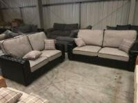 Brand new 3 + 2 black leather and grey fabric sofa suite
