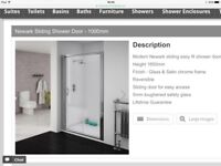Brand new shower screen still in box finished in satin chrome and measuring 1000mm