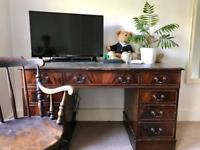 Lovely pedestal desk with green covered top