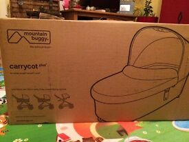 Mountain buggy carry cot plus solis colour, brand new in box.