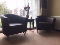 Two brown chocolate armchairs