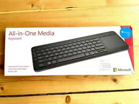 All-in-one Microsoft Media keyboard with integrated trackpad. Microsoft. Wireless USB.