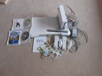 Wii fit console, board, Wii fit disc, Wii sports disc, sonic hedgehog game and two controls