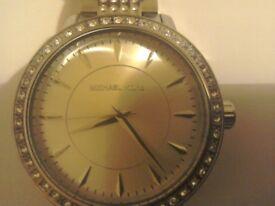 A nice looking man's or womans wrist watch maker m kors