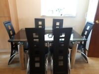 Extending Black Glass and Chrome Dining Table and Leather Chairs