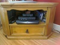 Pine corner TV cabinet with shelf and drawer in good condition .Rustic look