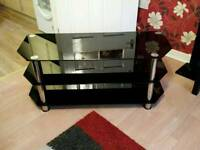 Black and silver tv stand