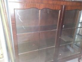 Glass fronted wooden free standing display cabinet with key.