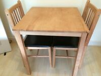 2-seater wooden dining table and 2- chairs (wooden frame with dark-brown leather seats)
