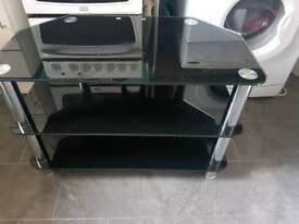 Glass table + 4 chairs, black glass tv stand and a large black mirror