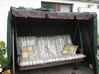 Garden Swing new with seat pads and waterproof cover