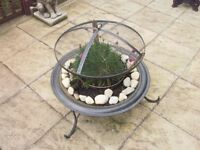Fire pit converted to planter