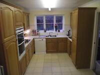 Complete Solid Wood Kitchen and Utility room units with Cathedral Arch doors . Condition is Used.