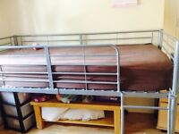 Single metal bunk bed one row with mattes.