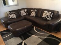 Brown leather corner sofa and large pouffe