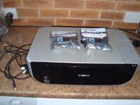 Canon Pixma 470 all in one printer with one spare new black and one spare new color cartidge