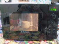 black chrome microwave digital Italian make Di Dietrich like new heats very well can deliver local
