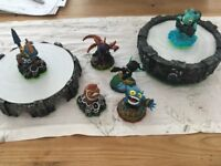 six skylander figures and two bases