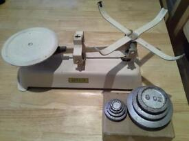Old fashion kitchen scales with a box of weights