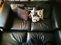 Black Land of Leather Four-Piece Sofa Set (including Puffle; One, Two & Three Seaters and Cushions)