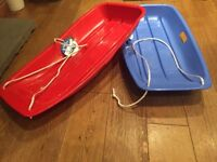12 sledges plastic for sale, blue and red 6 of each.