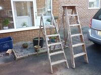 2 old wooden ladders