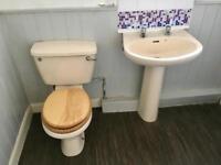 Cream bathroom suite with corner bath