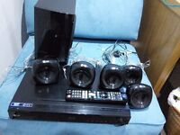 Blue ray home theatre cinema system. LG 405 bass bin and 5 speakers. Remote control.