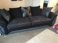 Black and grey DFS four seater sofa for sale!
