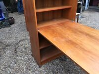 Tall bookcase with attached table/desk that folds away when not in use