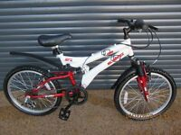 CHILDS SILVERFOX SUSPENSION BIKE IN EXCELLENT ALMOST NEW CONDITION, (SUIT APPROX. AGE 6 / 7+)..