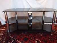 TV stand Black glass and chrome in first class condition.