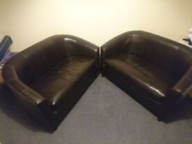 Two tub 2seater black leather style sofas
