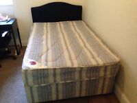 3/4 double bed base with black headboard and mattress