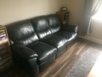 Black leather 3 seater recliner.
