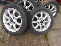 """ford 14"""" alloy wheels x4 with good tyres"""