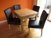 Solid oak folding table and 4x matching chairs