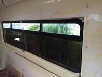 Transit ambulance side and rear window glass.
