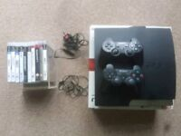 PS3 Slim Line edition 120gb 2 controllers and Ganes