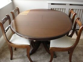 "Solid mahogany reproduction 48"" diameter extending dining table and four chairs."