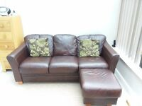 Brown leather sofa and foot stool. Excellent condition .