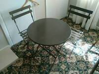 Metal bistro table & two chairs.