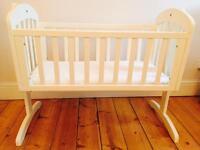 White swinging baby crib