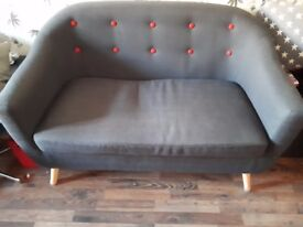 2 × 2 seater sofas colours charcoal one with grey buttons & 1 with red buttons